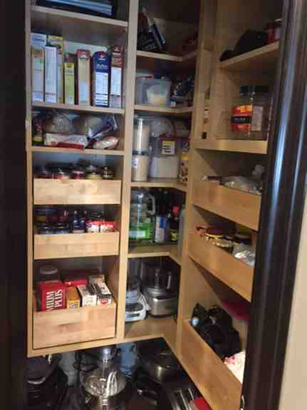 Our storage solutions range from custom shelving (for your kitchen, bathroom or garage), custom cutlery drawers, cookie sheet racks, lazy susans, pull out storage, and full pantry build-outs like this one!