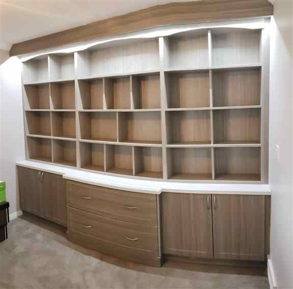 Our team designed and installed this custom storage unit for a customers music room.