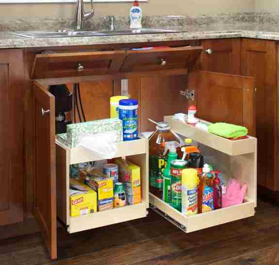 Even under the kitchen sink, custom two-level glide outs can store household chemicals, cleaning products, and other items typically found under a sink, while leaving room and access for the plumbing.