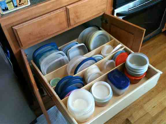 Keeping lids and plastic storage containers organized is made easier with our divider glide out.